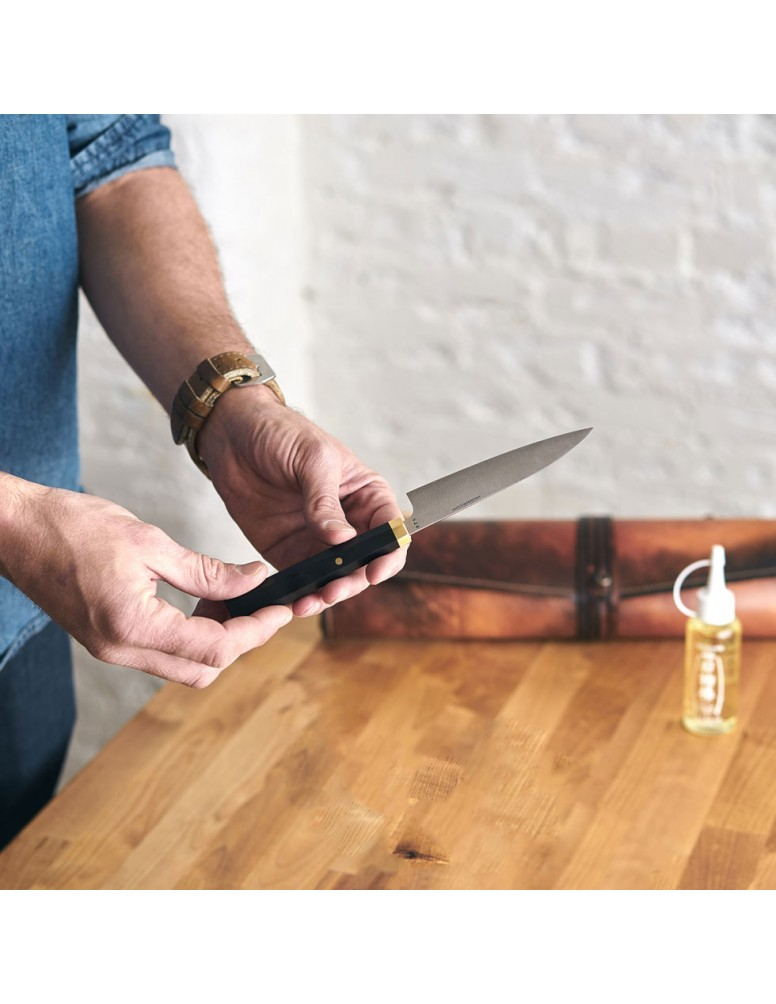 Parer LS115 paring knife in hand with Leather Chef Knife Roll.